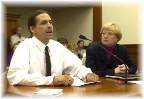 Photo of Lawrence Smith testifying in Lansing MI with Representative Susan Tabor